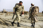 In this photo released on Tuesday, Jan. 19, 2021, by the Iranian Army, troops attend a military drill. Iran's military kicked off a ground forces drill on Tuesday along the coast of the Gulf of Oman, state TV reported, the latest in a series of snap exercises that the country is holding amid escalating tensions over its nuclear program and Washington's pressure campaign against Tehran. (Iranian Army via AP)