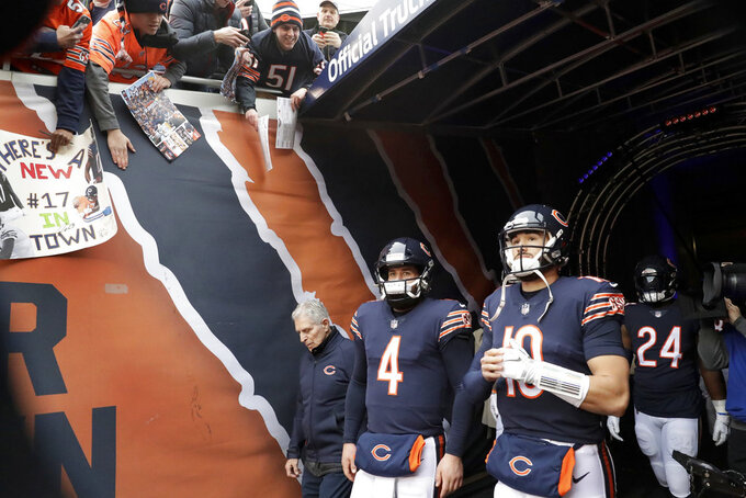 Chicago Bears quarterbacks Chase Daniel (4) and Mitchell Trubisky (10) walk out to the field before an NFL wild-card playoff football game against the Philadelphia Eagles Sunday, Jan. 6, 2019, in Chicago. (AP Photo/Nam Y. Huh)