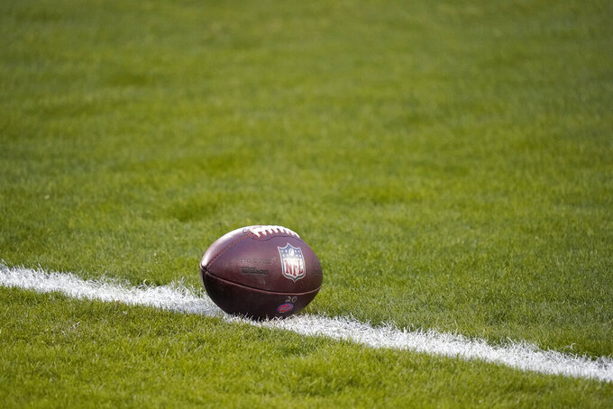 A football sits on the field before the AFC championship NFL football game between the Kansas City Chiefs and the Buffalo Bills, Sunday, Jan. 24, 2021, in Kansas City, Mo. (AP Photo/Jeff Roberson)