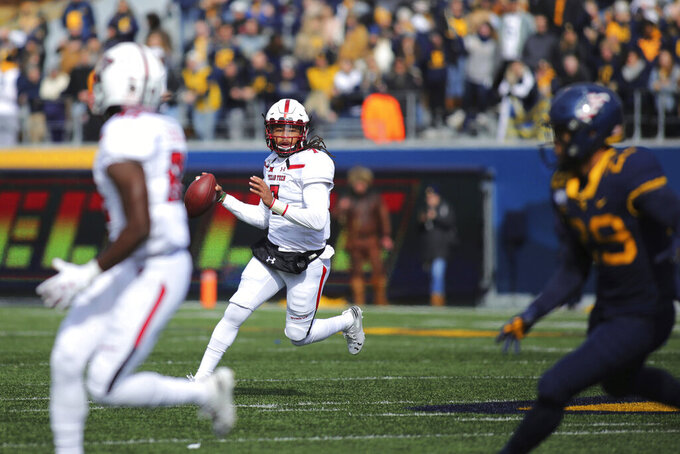 Texas Tech quarterback Jett Duffey (7) looks to pass in the first quarter of their NCAA college football game against West Virginia in Morgantown, W. Va., Saturday, Nov. 9, 2019. (AP Photo/Chris Jackson)