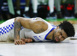 Kentucky's Nick Richards grimaces after falling to the court during the second half against Abilene Christian in a first-round game in the NCAA men's college basketball tournament in Jacksonville, Fla., Thursday, March 21, 2019. (AP Photo/Stephen B. Morton)