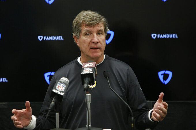 Washington Redskins head coach Bill Callahan speaks to the media following an NFL football game against the Carolina Panthers in Charlotte, N.C., Sunday, Dec. 1, 2019. (AP Photo/Brian Blanco)