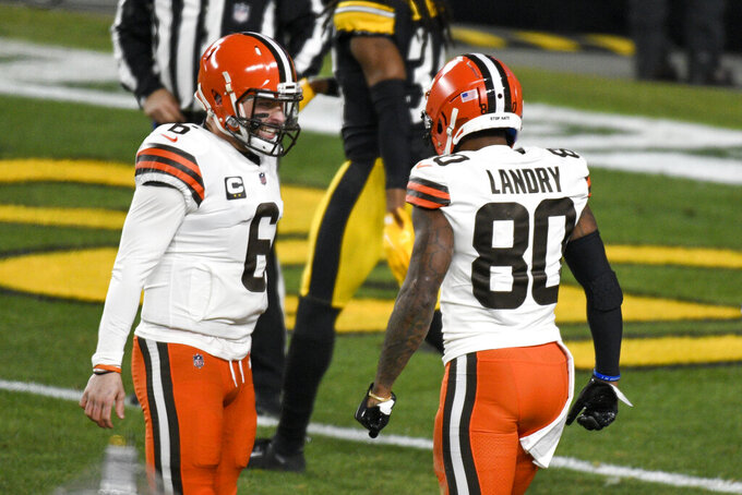 Cleveland Browns wide receiver Jarvis Landry (80) celebrates with quarterback Baker Mayfield after scoring a touchdown during the first half of an NFL wild-card playoff football game against the Pittsburgh Steelers in Pittsburgh, Sunday, Jan. 10, 2021. (AP Photo/Don Wright)