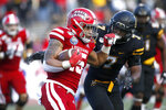 Louisiana-Lafayette running back Elijah Mitchell (15) fends off Appalachian State defensive back Josh Thomas (7) during a carry in the second half of an NCAA college football game in the Sun Belt Football Championship on Saturday, Dec. 7, 2019, in Boone, N.C. (AP Photo/Brian Blanco)