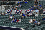 Fans watch during the second inning in Game 1 of a baseball National League Championship Series between the Los Angeles Dodgers and the Atlanta Braves Monday, Oct. 12, 2020, in Arlington, Texas. (AP Photo/Tony Gutierrez)