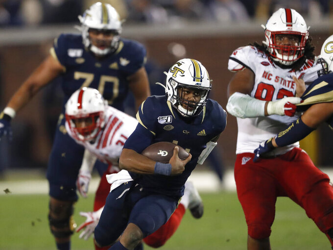 Georgia Tech quarterback James Graham (4) runs for a touchdown against North Carolina State during the second half of an NCAA college football game Thursday, Nov. 21, 2019, in Atlanta. Georgia Tech won 28-26. (AP Photo/John Bazemore)