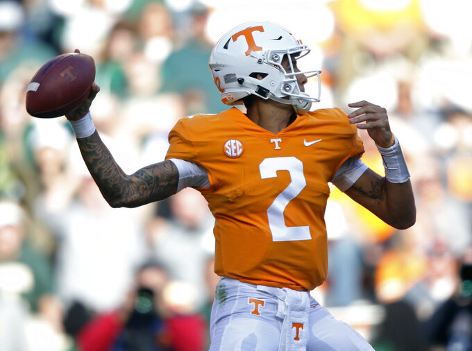 Tennessee quarterback Jarrett Guarantano (2) throws to a receiver during the first half of an NCAA college football game against Charlotte Saturday, Nov. 3, 2018, in Knoxville, Tenn. (AP Photo/Wade Payne)