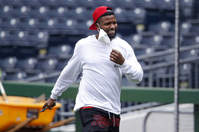 """Pittsburgh Pirates' Gregory Polanco arrives for a team workout at a """"summer camp"""" baseball practice in Pittsburgh, Tuesday, July 7, 2020. (AP Photo/Gene J. Puskar)"""