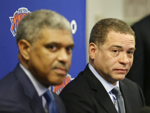 FILE - In this April 12, 2018, file photo, New York Knicks' general manager Scott Perry, right, and president Steve Mills listen during an NBA basketball news conference in Tarrytown, N.Y. The Knicks fired Mills on Tuesday, Feb. 4, 2020, a person with knowledge of the decision told The Associated Press. Perry will take over control of the basketball operations, according to the person, who spoke to the AP on condition of anonymity because no announcement had been made. (AP Photo/Seth Wenig, File)