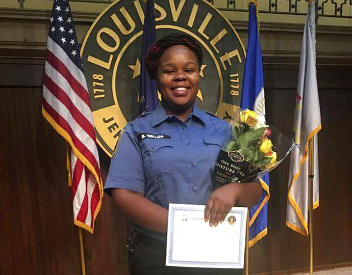 FILE - This undated photo provided by Taylor family attorney Sam Aguiar shows Breonna Taylor in Louisville, Ky.  (Courtesy of Taylor Family attorney Sam Aguiar via AP, File)