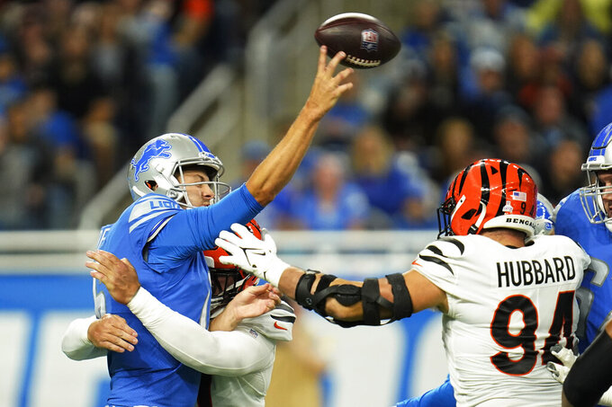 Detroit Lions quarterback Jared Goff is pressured by Cincinnati Bengals defensive end Trey Hendrickson during the first half of an NFL football game, Sunday, Oct. 17, 2021, in Detroit. (AP Photo/Paul Sancya)