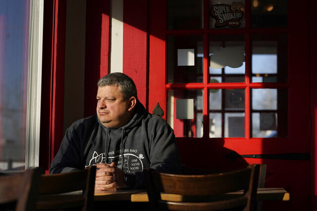 Jeff Fitter, owner of Super Smokers BBQ, poses for a photo inside his restaurant Thursday, Jan. 28, 2021, in Eureka, Mo. Fitter says his profits were down by about half last year, largely because of the closures and capacity limits imposed by St. Louis County. He is supporting a bill that would limit local emergency health orders to 14 days unless authorized for longer by the Legislature. (AP Photo/Jeff Roberson)