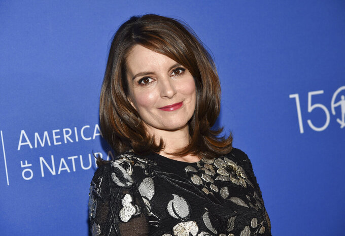 """FILE - In this Nov. 21, 2019, file photo, actress Tina Fey attends the American Museum of Natural History's 2019 Museum Gala in New York. Fey says more than $115 million was raised toward supporting New Yorkers impacted by COVID-19 during a virtual telethon. A tearful Fey said """"Thank you, thank you"""" in reaching the dollar amount as host of the Rise Up New York! event Monday, May 11, 2020. (Photo by Evan Agostini/Invision/AP, File)"""