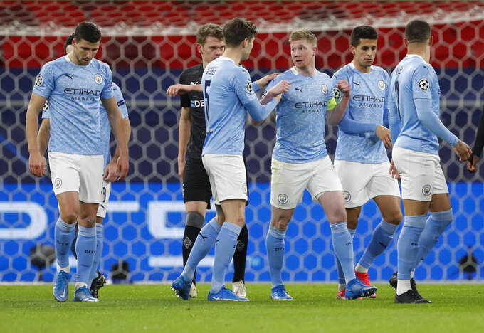 Manchester City's Kevin De Bruyne, third right, is congratulated by teammates after scoring his team's first goal during the Champions League round of 16 second leg soccer match between Manchester City and Borussia Moenchengladbach at the Puskas Arena in Budapest, Hungary, Tuesday, March 16, 2021. (AP Photo/Laszlo Balogh)