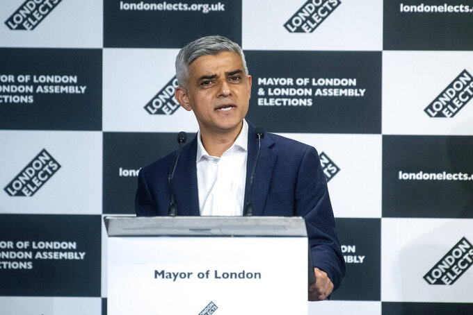 Labour's Sadiq Khan speaks after he was reelected and declared as the next Mayor of London at City Hall, in London, Saturday, May 8, 2021. (Victoria Jones/PA via AP)