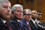 FILE - In this Feb. 11, 2020, file photo, a panel of witnesses, from left, Big 12 Conference Commissioner Bob Bowlsby, National Collegiate Athletic Association President Mark Emmert, University of Kansas Chancellor Dr. Douglas Girod, National College Players Association Executive Director Ramogi Huma and National Collegiate Athletic Association Student-Athlete Advisory Committee Chair Kendall Spencer, listen during a Senate Commerce subcommittee hearing on intercollegiate athlete compensation on Capitol Hill in Washington. The NCAA is moving closer to permitting Division I college athletes to earn money from endorsements and sponsorship deals they can strike on their own. Recommendations for changes to NCAA rules that would permit athletes to earn money for their names, images and likeness are being reviewed by college sports administrators this week before being sent to the association's Board of Governors.  (AP Photo/Susan Walsh, File)
