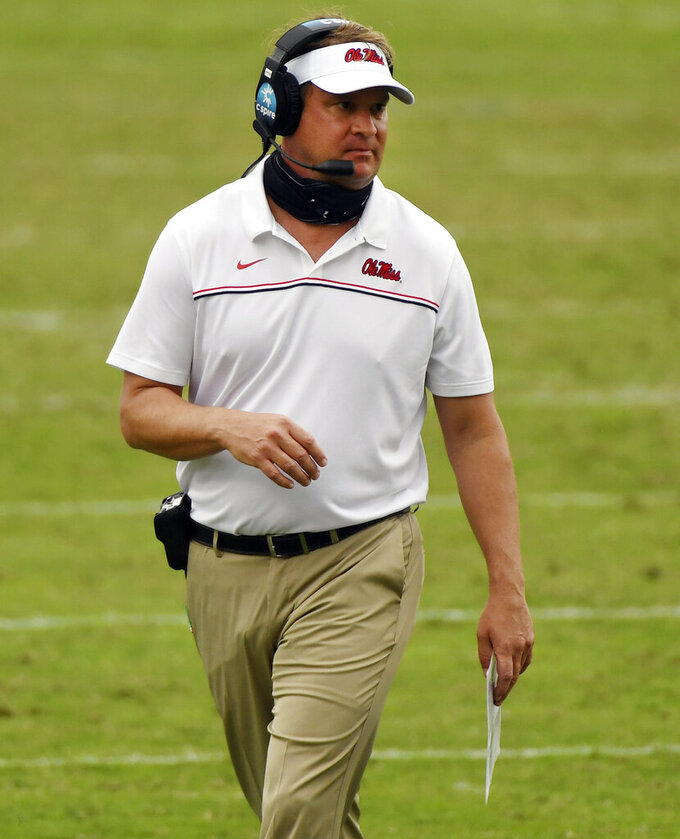 FILE - In this Sept. 26, 2020, file photo, Mississippi head coach Lane Kiffin walks on the field during the second half of an NCAA college football game against Florida in Oxford, Miss. Kiffin faces his old boss, Nick Saban, when the Rebels host No. 2 Alabama on Saturday. (AP Photo/Thomas Graning, File)