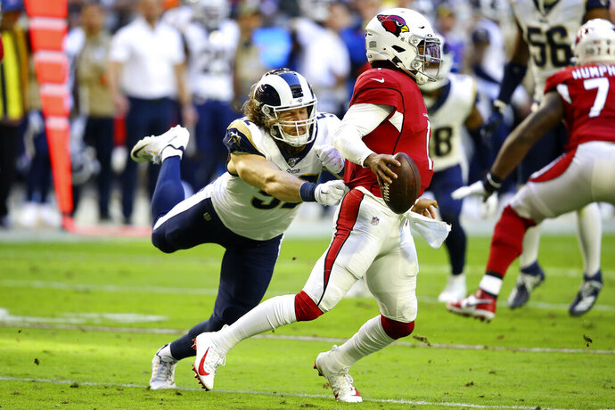 Arizona Cardinals quarterback Kyler Murray (1) is pressured by Los Angeles Rams outside linebacker Clay Matthews during the first half of an NFL football game, Sunday, Dec. 1, 2019, in Glendale, Ariz. (AP Photo/Ross D. Franklin)