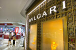 Shoppers walk past a Bulgari store at a shopping mall in Beijing, Tuesday, July 20, 2021. A popular Chinese-Canadian singer, Kris Wu, has lost endorsement and other deals with at least 10 brands including Porsche and Bulgari after a teen-ager accused him of having sex with her while she was drunk. (AP Photo/Mark Schiefelbein)
