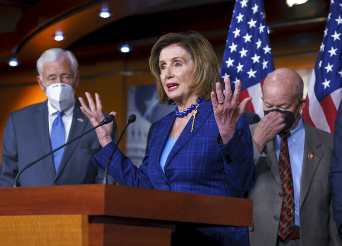 Speaker of the House Nancy Pelosi, D-Calif., flanked by Majority Leader Steny Hoyer, D-Md., left, and and Transportation and Infrastructure Committee Chair Peter DeFazio, D-Ore., discusses her legislative agenda, including voting rights, public health, and infrastructure, during a news conference at the Capitol in Washington, Friday, July 30, 2021. Hours before a nationwide eviction moratorium is set to expire, Pelosi is urging an extension in a longshot effort to prevent millions of Americans of being forced from their homes during a COVID-19 surge. (AP Photo/J. Scott Applewhite)