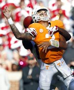 Tennessee quarterback Jarrett Guarantano (2) fumbles the ball as he's hit by Alabama defensive back Xavier McKinney (15) in the first half of an NCAA college football game against Alabama Saturday, Oct. 20, 2018, in Knoxville, Tenn. (AP Photo/Wade Payne)