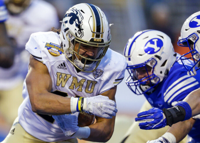 Western Michigan running back Chase Brown (28) runs up against the BYU defense on the goal line during the second half of the Famous Idaho Potato Bowl an NCAA college football game Friday, Dec. 21, 2018, in Boise, Idaho. BYU won 49-18. (AP Photo/Steve Conner)