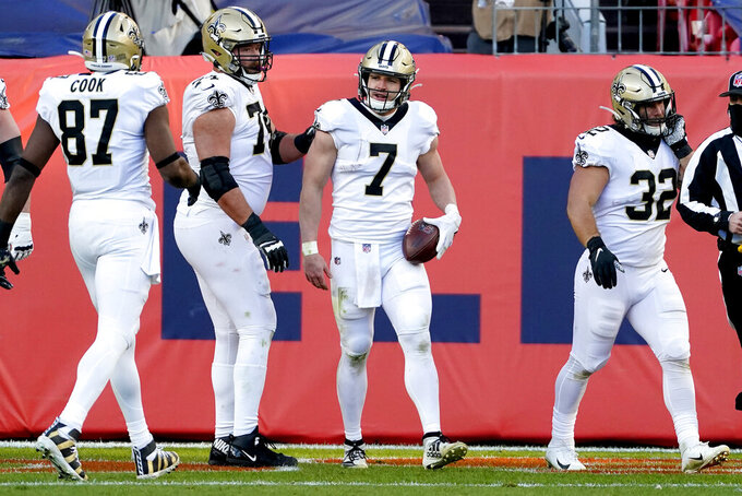 New Orleans Saints quarterback Taysom Hill (7) celebrates his rushing touchdown against the Denver Broncos during the first half of an NFL football game, Sunday, Nov. 29, 2020, in Denver. (AP Photo/Jack Dempsey)