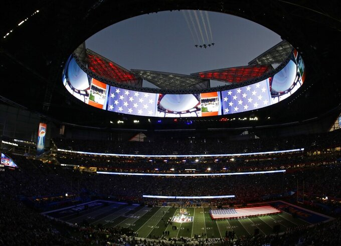 Gladys Knight sings the national anthem as the U.S. Air Force Thunderbirds fly over Mercedes-Benz Stadium before the NFL Super Bowl 53 football game between the Los Angeles Rams and the New England Patriots, Sunday, Feb. 3, 2019, in Atlanta. (AP Photo/Charlie Riedel)