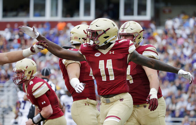 Boston College wide receiver CJ Lewis (11) celebrates with teammates after scoring a touchdown during the second half of a college football game against Holy Cross, Saturday, Sept. 8, 2018, in Boston. (AP Photo/Mary Schwalm)