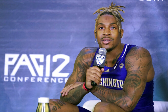 Washington's Nate Roberts speaks during Pac-12 Conference NCAA college basketball media day Wednesday, Oct. 13, 2021, in San Francisco. (AP Photo/Jeff Chiu)
