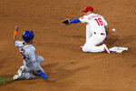 New York Mets' Dominic Smith, left, steals second base as Philadelphia Phillies second baseman Cesar Hernandez reaches for the throw during the sixth inning of a baseball game Wednesday, June 26, 2019, in Philadelphia. Smith advanced to third. (AP Photo/Matt Slocum)