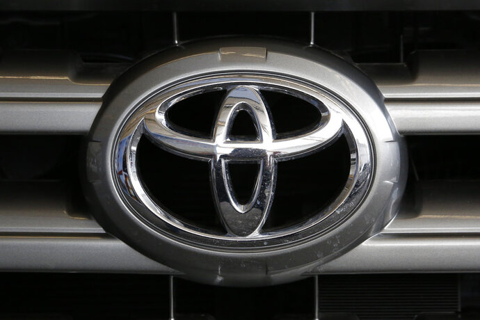 FILE- This Feb. 11, 2016, file photo shows a Toyota logo on the hood of a 2016 Toyota Sequoia on display at the Pittsburgh International Auto Show in Pittsburgh. Toyota is recalling nearly 188,000 pickup trucks, SUVs and cars worldwide because the air bags may not inflate in a crash. The recall covers 2018 and 2019 Tundra pickups and Sequoia SUVs as well as 2019 Avalon sedans. (AP Photo/Gene J. Puskar, File)
