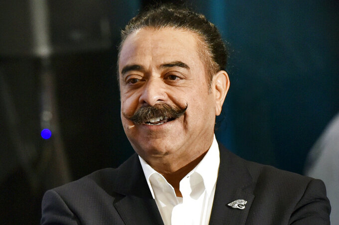 """FILE - Jacksonville Jaguars owner Shad Khan speaks at EverBank Field in Jacksonville, Fla., in this March 8, 2017, file photo. It's easy to see owner Shad Khan's excitement and enthusiasm for the Jacksonville Jaguars these days. He's laughing, cracking jokes, taking subtle shots at the previous coach/general manager regime. """"It's unbelievable,"""" Khan said Tuesday, April 27, 2021, two days before Jacksonville is set to select Clemson quarterback Trevor Lawrence with the first pick in the NFL draft. """"If this isn't a moment to enjoy for me and for all the Jags fans, you need more coffee or you need something else. This is a great-to-be-alive kind of moment, frankly."""" (Will Dickey/The Florida Times-Union via AP, File)"""