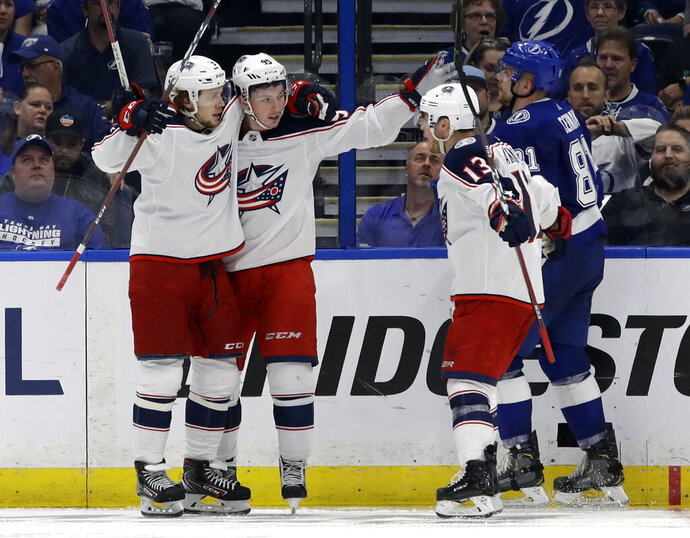 Columbus Blue Jackets center Matt Duchene (95) celebrates his goal against the Tampa Bay Lightning with teammates, including right wing Cam Atkinson (13), during the second period of Game 2 of an NHL Eastern Conference first-round hockey playoff series Friday, April 12, 2019, in Tampa, Fla. (AP Photo/Chris O'Meara)