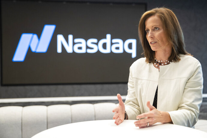 In this Wednesday, July 31, 2019, photo shows NASDAQ President and Chief Executive Officer Adena Friedman speaks an interview at NASDAQ headquarters in New York. The U.S. stock market has thousands fewer companies to choose from, and that's doing a disservice to regular investors, says Friedman. In a recent conversation with the AP, she discussed what's behind the trend and how it could be exacerbating income inequality. (AP Photo/Mary Altaffer)
