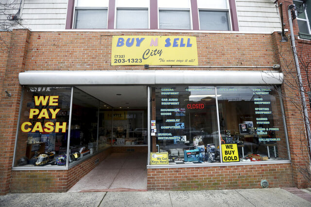 This Sunday, Dec. 15, 2019 photo shows the family-owned Buy n Sell pawn shop searched by the FBI over the weekend in Keyport, N.J. A New Jersey man whose number was found in the back pocket of one of the perpetrators of last week's fatal attack on a Jewish market has been arrested for illegally possessing a weapon. The number belonged to Ahmed A-Hady, and the address was for a storefront for the pawnshop. (Ed Murray/NJ Advance Media via AP)