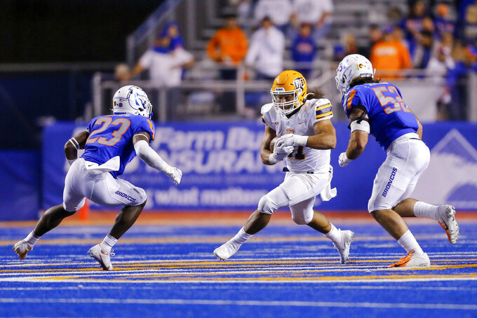 UTEP fullback James Tupou (31) runs with the ball as Boise State safety Seyi Oladipo (23) and linebacker DJ Schramm (52) close in during the second half of an NCAA college football game Friday, Sept. 10, 2021, in Boise, Idaho. (AP Photo/Steve Conner)