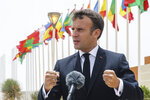 French President Emmanuel Macron speaks to the press upon arrival at Nouakchott Oumtounsy International Airport Tuesday June 30, 2020, in Nouakchott, to attend a G5 Sahel summit. Leaders from the five countries of West Africa's Sahel region, Burkina Faso, Chad, Mali, Mauritania and Niger, meet with French President Emmanuel Macron and Spanish Prime Minister Pedro Sanchez in Mauritania's capital Nouakchott on Tuesday to discuss military operations against Islamic extremists in the region, as jihadist attacks mount. The five African countries, known as the G5, have formed a joint military force that is working with France, which has thousands of troops to battle the extremists in the Sahel, the region south of the Sahara Desert. (Ludovic Marin, Pool via AP)