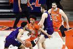 Northwestern's guard Boo Buie (0) pushes Illinois guard Andre Curbelo (5) as teammate center Ryan Young (15) sets a block on forward Giorgi Bezhanishvili (15) in the first half of an NCAA college basketball game Tuesday, Feb. 16, 2021, in Champaign, Ill. (AP Photo/Holly Hart)