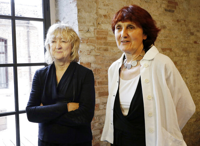 FILE - In this May 23, 2018 file photo, Biennale International Architecture exhibition curators Yvonne Farrell, left, and Shelley McNamara appear in Venice, Italy. Farrell and McNamara, of Dublin, Ireland, have been named recipients of the 2020 Pritzker Prize. (AP Photo/Antonio Calanni, File)