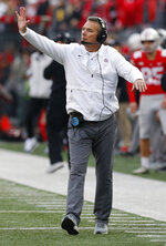 Ohio State head coach Urban Meyer signals to his team during the second half of an NCAA college football game against Michigan, Saturday, Nov. 24, 2018, in Columbus, Ohio. Ohio State beat Michigan 62-39. (AP Photo/Jay LaPrete)