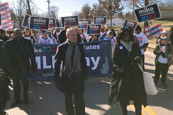 "In this Jan. 20, 2020 photo, former New York City Mayor, and Democratic presidential candidate Michael Bloomberg walks with supporters along the route of the Little Rock ""marade"" marking the Martin Luther King Jr. holiday in Little Rock, Ark. (AP Photo/Andrew DeMillo)"