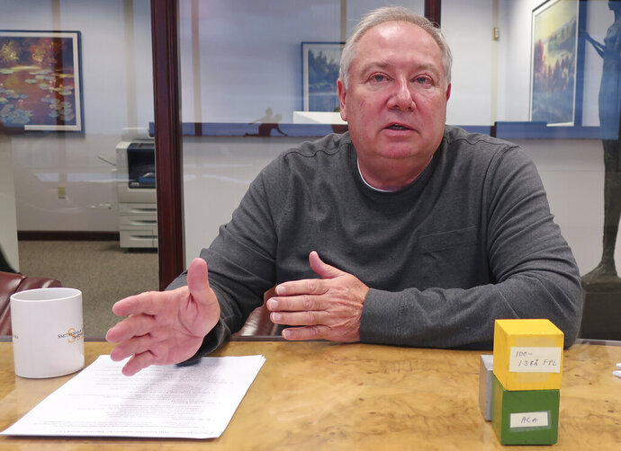 Kansas Senate Majority Leader Jim Denning, R-Overland Park, discusses the details of a plan for expanding Medicaid in Kansas during an interview, Monday, Oct. 21, 2019, at a law office in Overland Park, Kansas. Denning's plan would increase tobacco taxes and doesn't contain a work requirement for Medicaid participants but differs significantly from a plan Democratic Gov. Laura Kelly favors. (AP Photo/John Hanna)