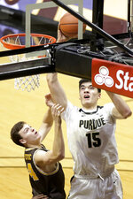 Purdue center Zach Edey (15) goes up for a layup next to Valparaiso's Jacob Ognacevic during an NCAA college basketball game Friday, Dec. 4, 2020, in West Lafayette, Ind. (Nikos Frazier/Journal & Courier via AP)