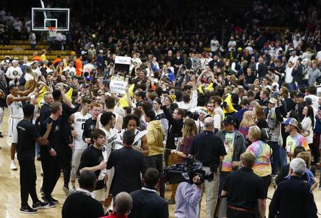 Colorado fans storm court