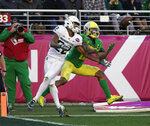 Oregon wide receiver Dillon Mitchell, right, catches a touchdown pass in front of Michigan State cornerback Josiah Scott (22) during the second half of the Redbox Bowl NCAA college football game Monday, Dec. 31, 2018, in Santa Clara, Calif. (AP Photo/Tony Avelar)