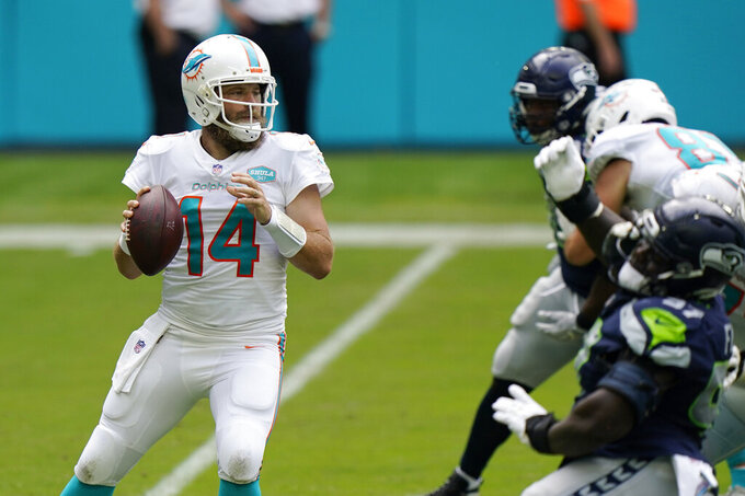 Miami Dolphins quarterback Ryan Fitzpatrick (14) looks to pass the ball during the first half of an NFL football game against the Seattle Seahawks, Sunday, Oct. 4, 2020 in Miami Gardens, Fla. (AP Photo/Wilfredo Lee)