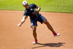 Washington Nationals' Wilmer Difo (1) fields a ball as the Washington Nationals hold their first baseball training camp work out at Nationals Stadium, Friday, July 3, 2020, in Washington. (AP Photo/Andrew Harnik)