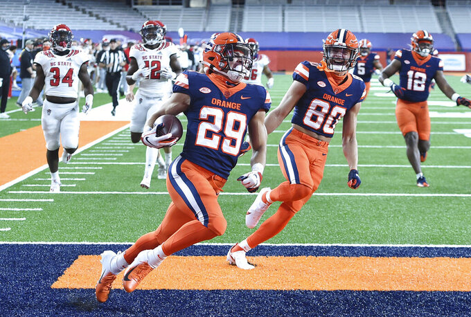 Syracuse wide receiver Trebor Pena (29) runs back a kickoff for a touchdown during the first half of an NCAA college football game against North Carolina State on Saturday, Nov. 28, 2020, at the in Syracuse, N.Y. (Scott Schild /The Post-Standard via AP)