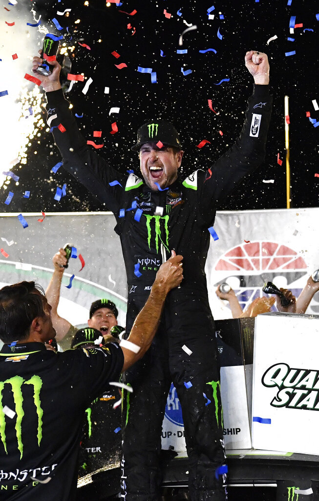Kurt Busch celebrates his victory in the NASCAR Cup Series auto race at Kentucky Speedway in Sparta, Ky., Saturday, July 13, 2019. (AP Photo/Timothy D. Easley)